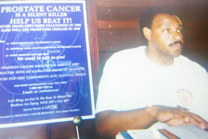 Prostate Cancer Resource volunteer Frank Smith at information table