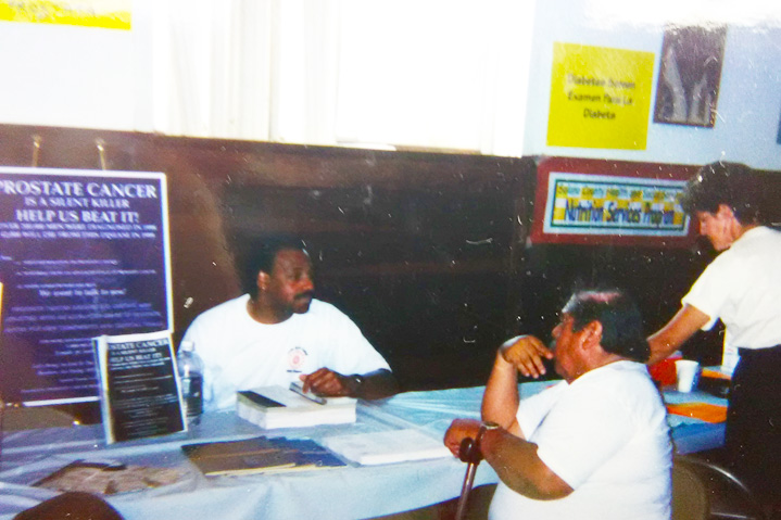 Photo of African American speaking with client
